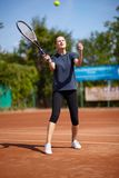 Tennis player executing a forehand volley Royalty Free Stock Photos