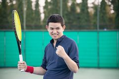 Tennis player expresses his victory in the game stock images