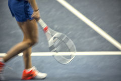 Tennis player, fast movement, defocus. Young woman playing tennis. Tennis player, fast movement, defocus Royalty Free Stock Photography