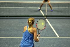 Tennis player, fast movement, defocus. Young woman playing tennis. Tennis player, fast movement, defocus Stock Photos