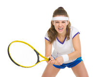 Tennis player during a fierce battle. Isolated on white royalty free stock photography