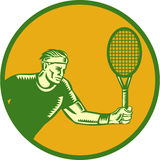 Tennis Player Forehand Circle Woodcut. Illustration of a tennis player holding racquet playing tennis doing a forehand shot set inside circle done in retro Royalty Free Stock Image