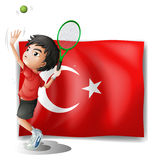 A tennis player in front of the flag of Turkey Royalty Free Stock Images