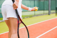 Tennis player getting ready to serve Stock Images