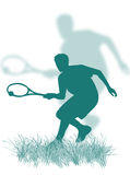 Tennis player on the grass Stock Photography