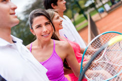 Tennis player with a group Royalty Free Stock Images