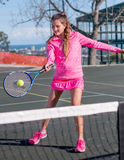 Tennis player. Hitting ball over net stock images