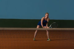 Tennis Player Hitting The Ball On Tennis Court Royalty Free Stock Image