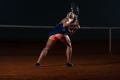 Tennis Player Hitting The Ball On Tennis Court Stock Images
