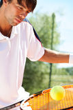 Tennis player hitting the ball Royalty Free Stock Image