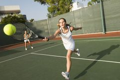 Tennis Player Hitting A Shot Royalty Free Stock Image