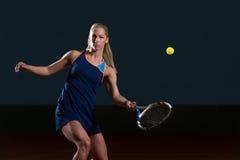 Tennis Player Hitting Tennis Ball Royalty Free Stock Photography