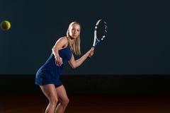 Tennis Player Hitting Tennis Ball Royalty Free Stock Images