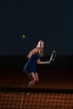 Tennis Player Hitting Tennis Ball Stock Photography
