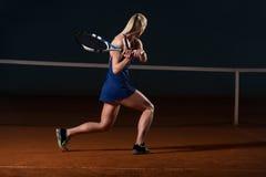 Tennis Player Hitting Tennis Ball Royalty Free Stock Image