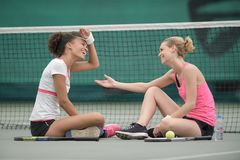 Tennis player holding out hand to opponent Stock Photography