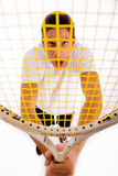 TENNIS PLAYER HOLDING RACKET. Front view of male carrying racket on an isolated white background Stock Images