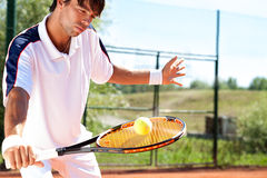 Tennis player. Holding racket with ball Royalty Free Stock Photography