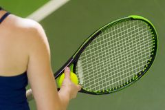 Tennis player holding racket and ball in hands royalty free stock photo