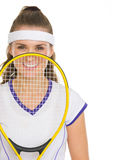 Tennis player holding racket in front of face Royalty Free Stock Photography