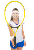 Tennis player holding racket in front of face Royalty Free Stock Images