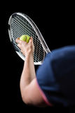 Tennis player holding a racquet ready to serve Royalty Free Stock Image