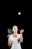 Tennis player holding a racquet ready to serve Royalty Free Stock Photos