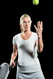 Tennis player holding a racquet ready to serve Stock Images