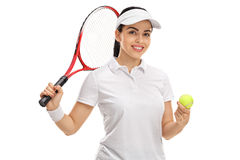 Tennis player holding a tennis ball and a racket Stock Photography