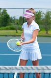 Tennis player holding tennis racket and ball on the tennis court stock photos