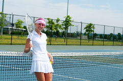 Tennis player holding tennis racket and ball on the tennis court stock photo