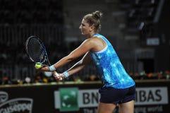 Tennis player Irina Begu training before a match Royalty Free Stock Photos