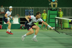 Tennis player Jamie Murray of Great Britain in action during men`s doubles first round match of the Rio 2016 Olympic Games Royalty Free Stock Photography