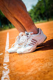 Tennis player leg Stock Images