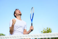 Tennis player man winning cheering victory. Tennis player man winning cheering celebrating victory. Winner man happy in celebration of success and win. Fit male Royalty Free Stock Photos