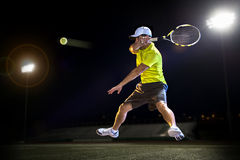 Tennis player at night Royalty Free Stock Photography