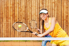 Tennis player playing match on the court in summer Royalty Free Stock Photos
