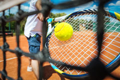 Tennis player playing a match. With green ball Stock Images