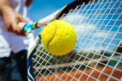 Tennis player playing a match. With green ball Stock Photos