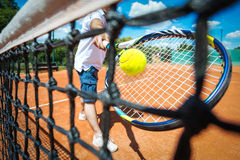 Tennis player playing a match. With green ball Royalty Free Stock Photos