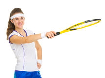 Tennis player pointing on copy space with racket Royalty Free Stock Image