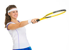 Tennis player pointing with racket on copy space Stock Photo