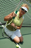 Tennis player portrait. Potrait of an active senior woman on a tennis court stock images