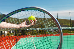 Tennis player prepares to serve a tennis ball Royalty Free Stock Images