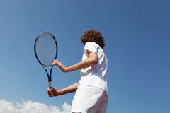Tennis player with racket during a match game Royalty Free Stock Images