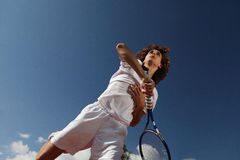 Tennis player with racket during a match game Stock Photos