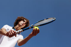 Tennis player with racket during a match game Royalty Free Stock Image