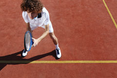 Tennis player with racket during a match game Stock Photography