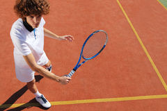 Tennis player with racket during a match game Stock Images