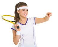 Tennis player with racket pointing on copy space Royalty Free Stock Photos